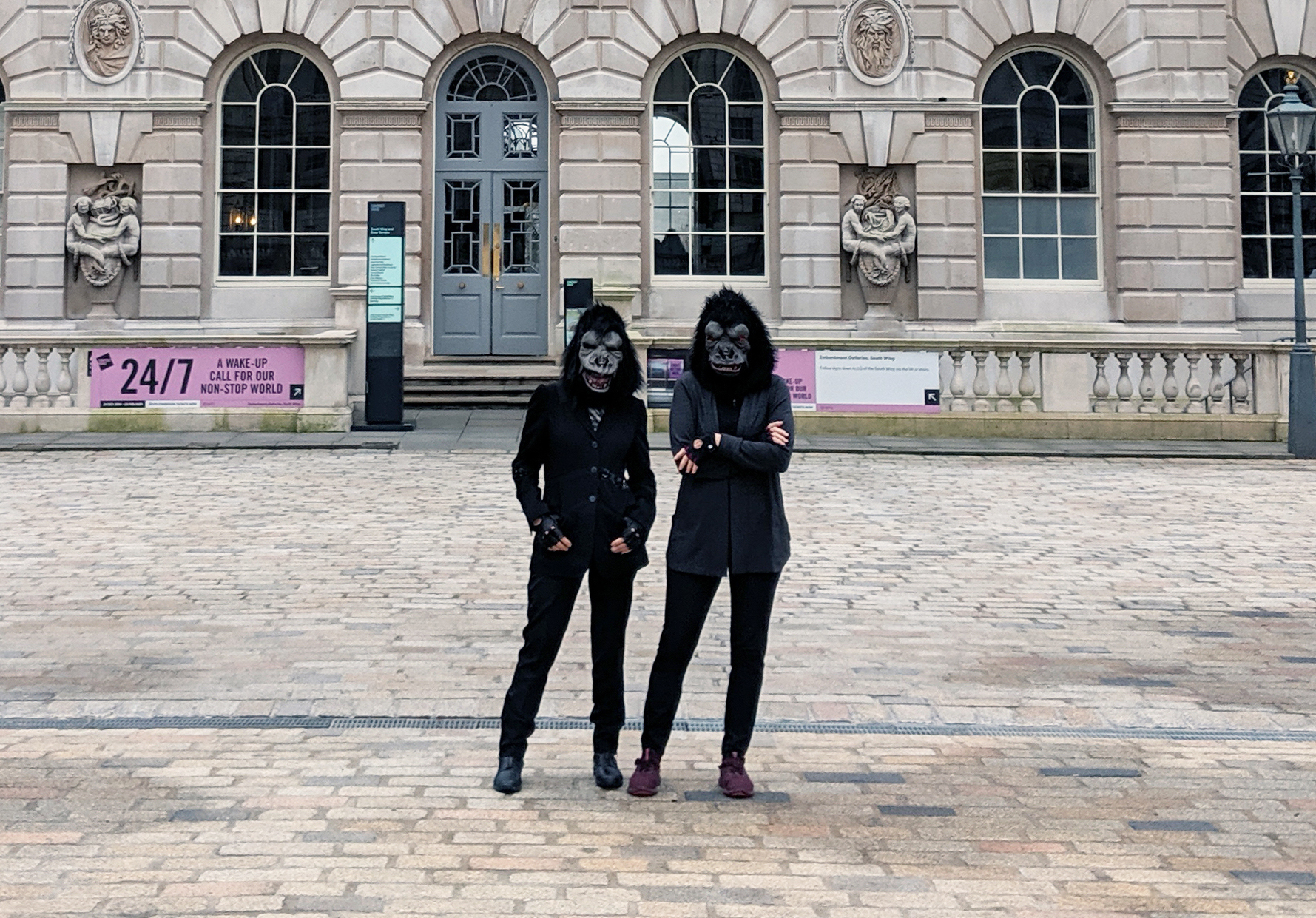 Two people in gorilla masks stand in the courtyard of Somerset House