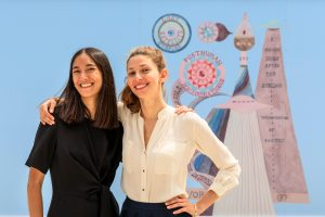 Philippine Nguyen and Ksenia Zemtsova, the founders of Art Night in front at Battersea Power Station, in front of the Suzanne Treister mural